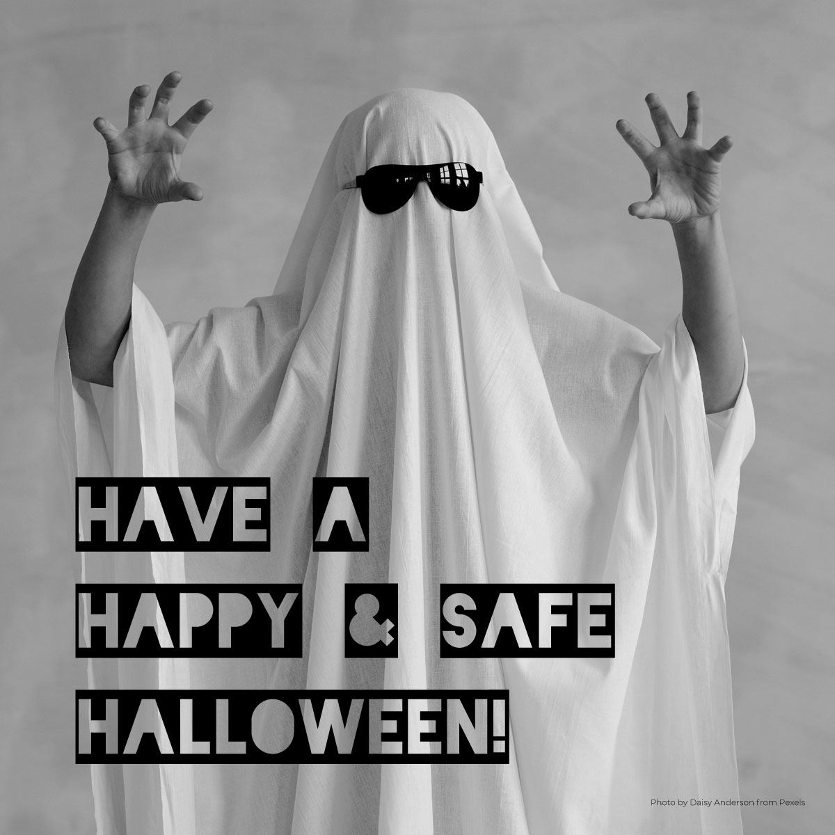 Person in a ghost costume, Have a Happy and Safe Halloween