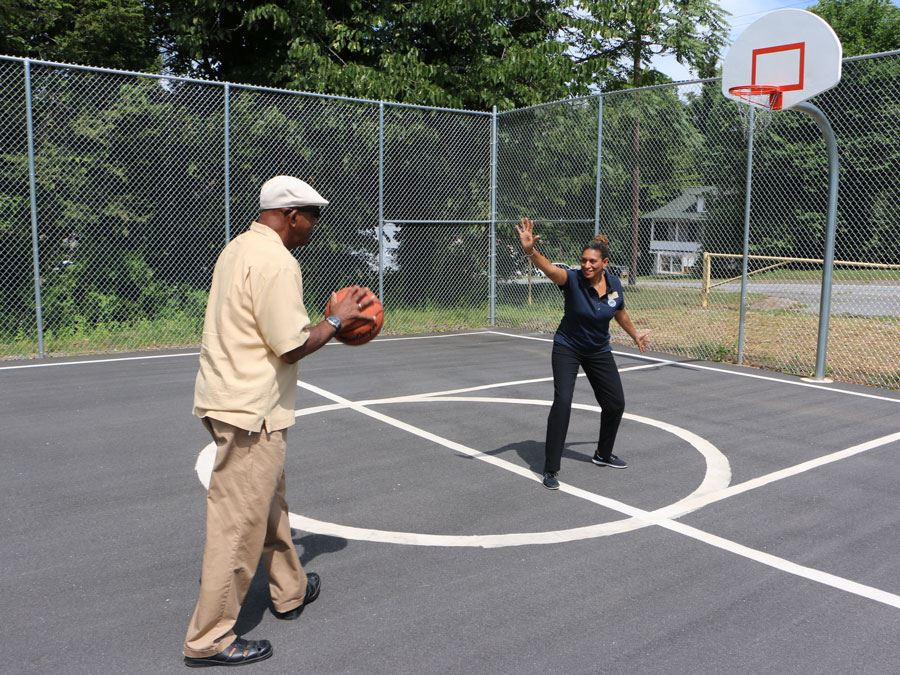 Ike Perkins and Crissy Thomas play basketball at J.E. Broyhill Park in Lenoir.